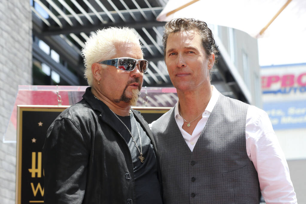 Guy Fieri, left, and Matthew McConaughey speak following a ceremony honoring Guy Fieri with a star at the Hollywood Walk of Fame on Wednesday, May 22, 2019, in Los Angeles. (Photo by Willy Sanjuan/Invision/AP)