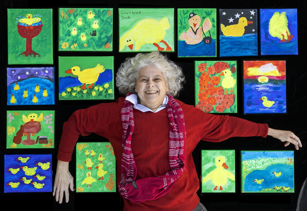 """Angela Marciano painted a series of small canvasses for her children's book """"Limoncello and the Great Illness."""" Marciano submitted the pieces and the book for the Sonoma Responds exhibit sponsored by the Sonoma County Library.  (John Burgess / The Press Democrat)"""