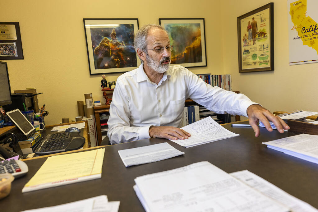 Keith Becker, manager of DeDe's Rentals, has 14 tenants who owe more than $100,000 in back rent. So far, only three have received assistance. The state legislature is considering extending the statewide eviction protections as rental aid has been slow to reach tenants.  (John Burgess/The Press Democrat)
