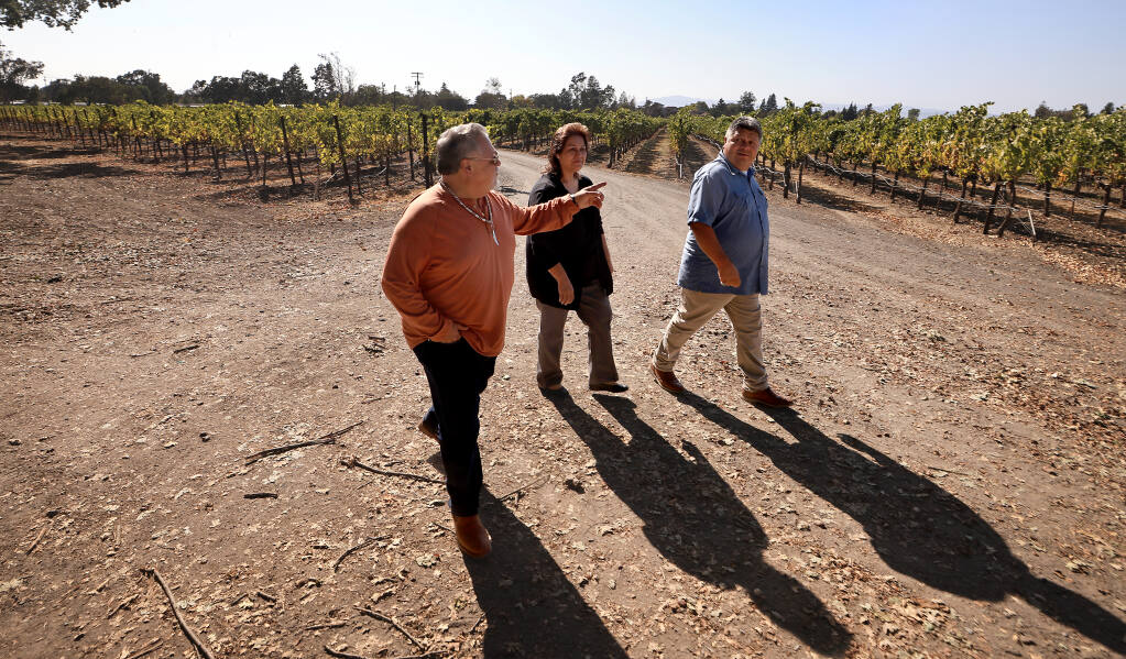 From left, Dino Beltran, Judy Fast Horse and Darin Beltran of Sonoma County's Native American Koi Nation, tour a portion of the 68 acres of land purchased by the tribe on East Shiloh Road, south of the Windsor town limit, where they plan to build a resort casino, Friday, Sept. 17, 2021.  (Kent Porter / The Press Democrat) 2021