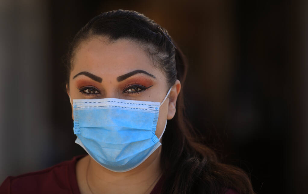 Carmen Amavisca, a housekeeper at Santa Rosa Memorial Hospital, Friday, March 19, 2021, received her first dose of Pfizer-BioNTech vaccine on Dec. 22, but at the same time contracted COVID.  (Kent Porter / The Press Democrat) 2021