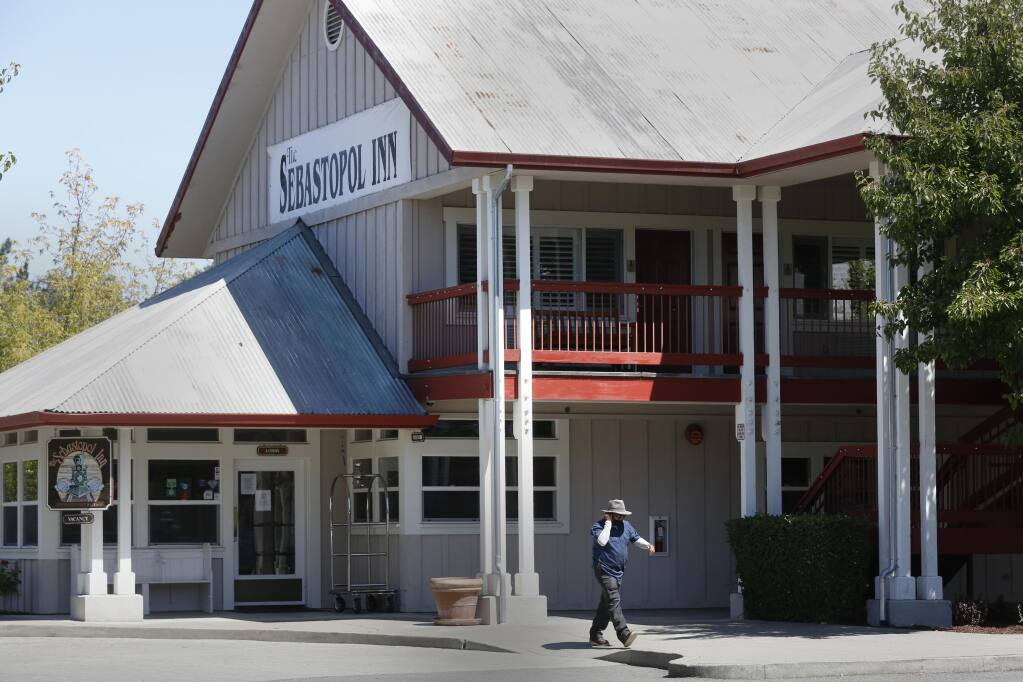 A man walks outside The Sebastopol Inn in Sebastopol on Monday, Aug. 3, 2020. (Beth Schlanker / The Press Democrat)