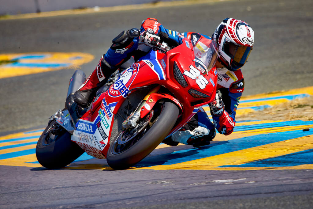 Jayson Uribe, Napa County firefighter, races his motorcycle at Sonoma Raceway. (Mike Doran)