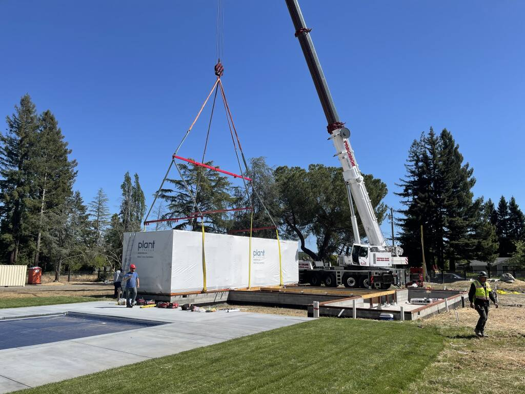 A Plant Module being set on the foundation in Kenwood. The modules were shipped complete with interior and exterior finishes for minimal on-site finish work. | Courtesy of Plant Prefab