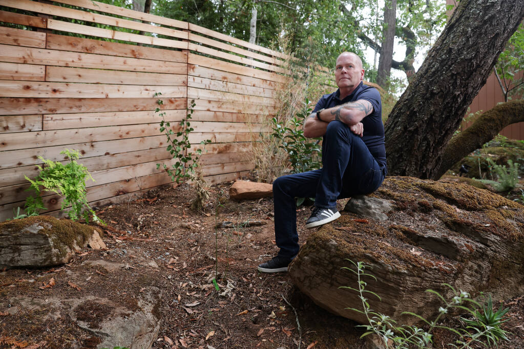 Dale Sessions is advocating for regulations on short term rentals because of a house next-door to his home in Santa Rosa that he and neighbors say has been used for successive parties. Sessions built a tall fence to try to block some of the noise from parties held at the short term rental property.  (Christopher Chung/ The Press Democrat)