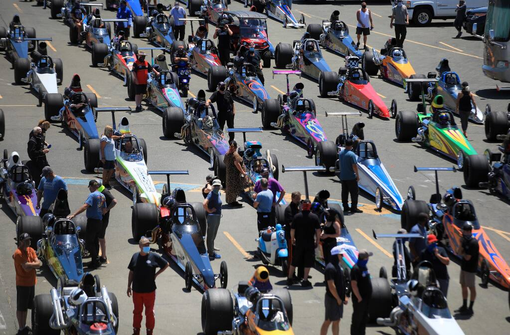 NHRA Division 7 competitors and support personnel prepare for early round qualifying at Sonoma Raceway, Thursday, July 16, 2020 in Sonoma.  More than 700 people, sans spectators, are on hand for the racing.  (Kent Porter/The Press Democrat)