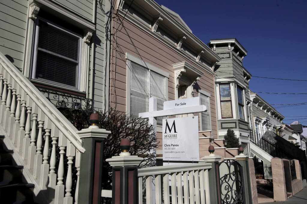 A real estate sign is shown in front of a home for sale in San Francisco on Feb. 18, 2020. Californians approved a ballot measure that adds and strips exemptions to property taxes, giving more breaks to seniors, disabled and wildfire victims when they move and taking them away from people who turn inheritances into investment homes. Proposition 19, which received 51% of the votes, is expected to produce additional revenue for schools, local governments and firefighting districts. (AP Photo/Jeff Chiu, File)