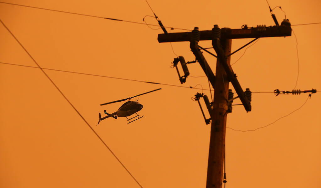 A PG&E helicopter inspects electric lines along Los Alamos Road in Santa Rosa after a power shutdown in 2020.  (CHRISTOPHER CHUNG / The Press Democrat)