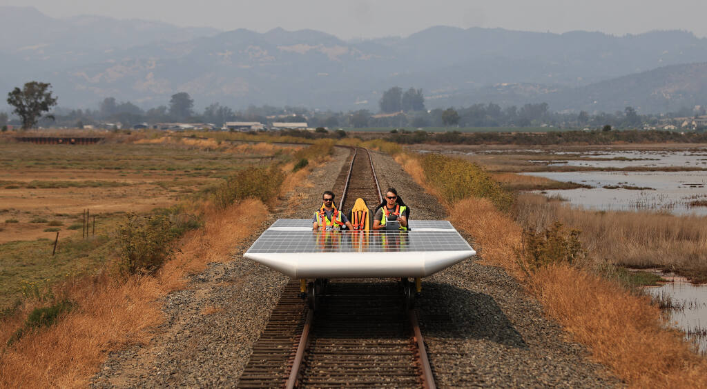 Eric Houston, left, and Marco Fucci di Napoli take the Solar Train out for a spin in the Schellville area of Sonoma County, Friday, Aug. 20, 2021 , where they will attempt a world speed record on Saturday. (Kent Porter / The Press Democrat) 2021