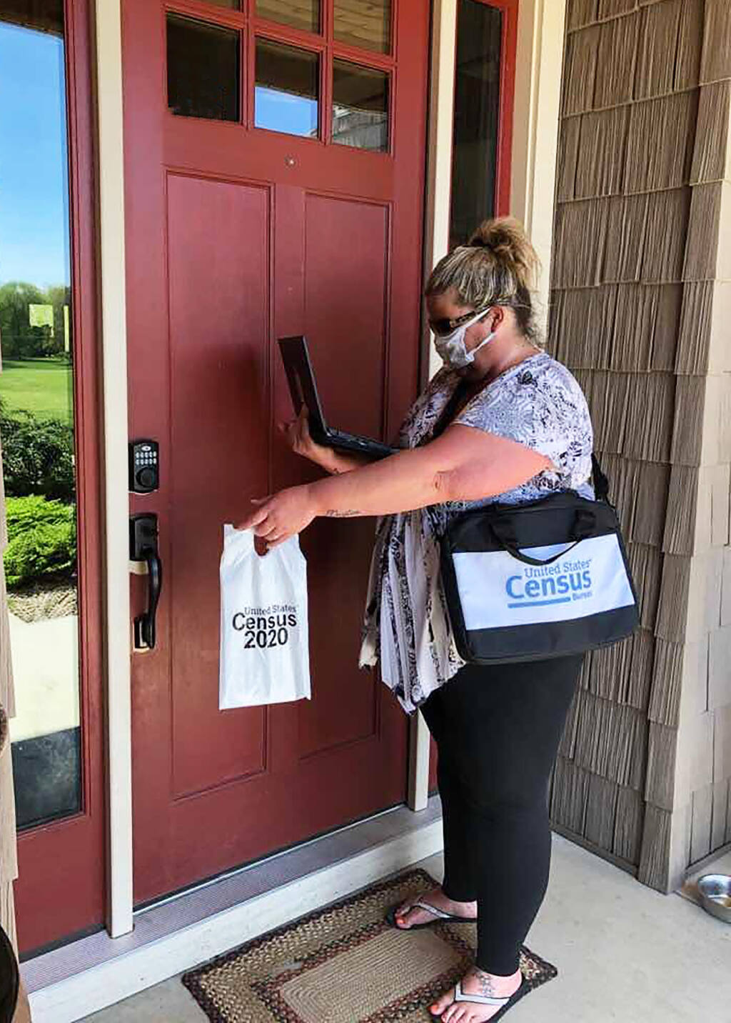 U.S. Census Bureau staff will follow local health official guidance when wearing Protective Personal Equipment as they go to the doors of 'non-respondent households' in August and September.