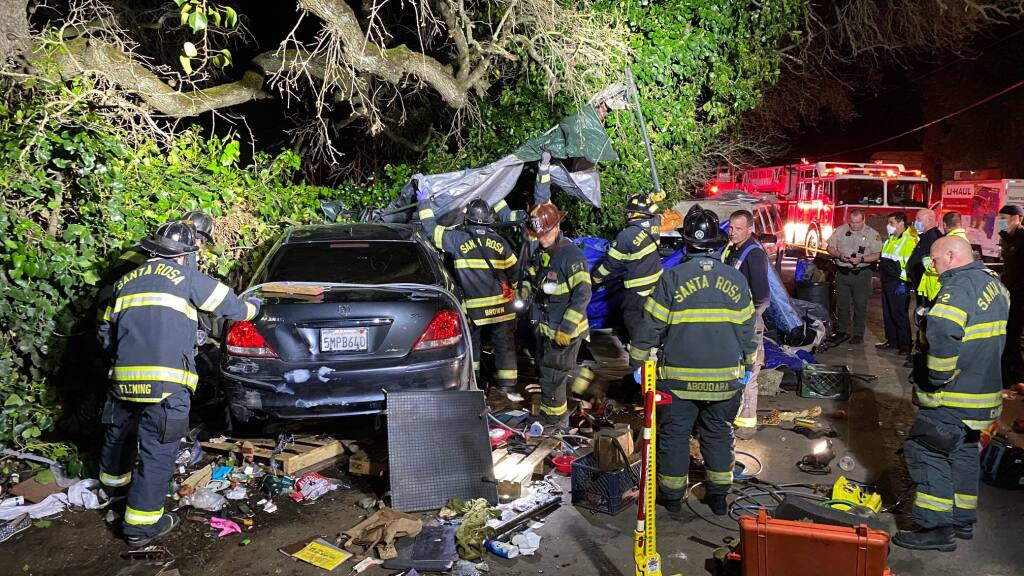 At least two people were injured late on Tuesday, March 23, 2021, after a vehicle plowed into a homeless encampment in southwest Santa Rosa. (Kent Porter / The Press Democrat)