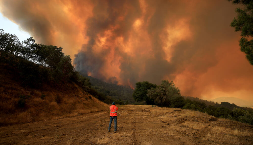 The Hennessey fire approaches Turtle Rock, Tuesday, August 18, 2020 near Lake Berryessa. (Kent Porter / The Press Democrat) 2020