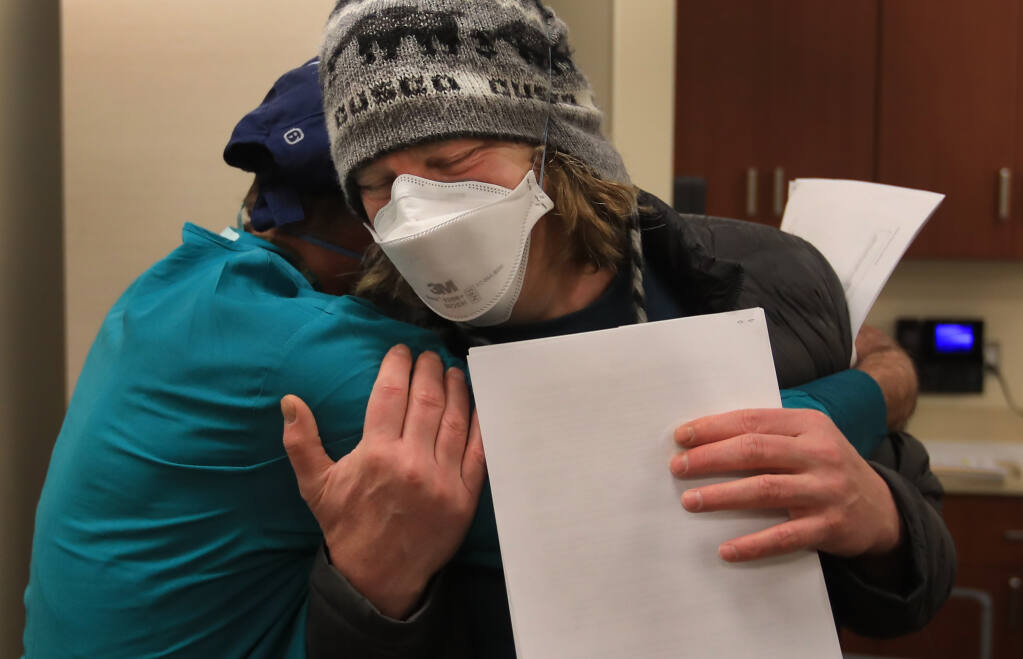 Emergency Department doctors Craig Cohen, front, and Steven Friesse share an embrace after both were vaccinated against COVID-19 at Sutter Santa Rosa Regional Hospital, Sunday, Dec. 20, 2020. (Kent Porter / The Press Democrat) 2020