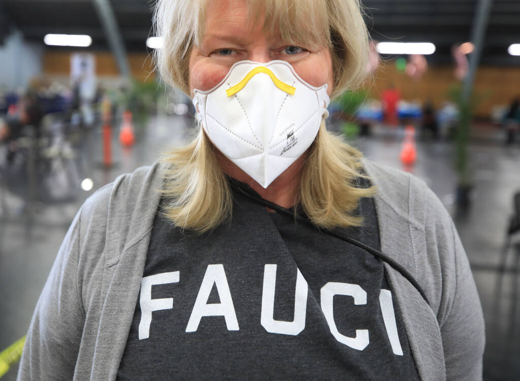 Ellen Tucker of Santa Rosa wore her favorite vaccination shirt to get her second dose of the Moderna vaccine from the Sonoma County Medical Association's clinic at the Sonoma County Fairgrounds, Wednesday, March 3, 2021, in Santa Rosa. (Kent Porter / The Press Democrat) 2021