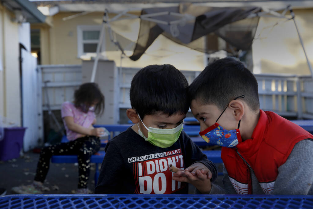 Friends Isaac Alcazar, 4, and Isaiah Torres, 5, share a moment together at A Special Place Therapeutic Preschool in Santa Rosa, Calif., on Monday, November 30, 2020. Photo taken (BETH SCHLANKER/ The Press Democrat)