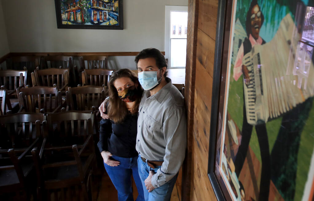 Rob, right, and Karla Lippincott of The Parish Café in Healdsburg are selling their New Orleans-style restaurant in a plan to depart California, on Thursday, Jan. 8, 2021.(Kent Porter / The Press Democrat)