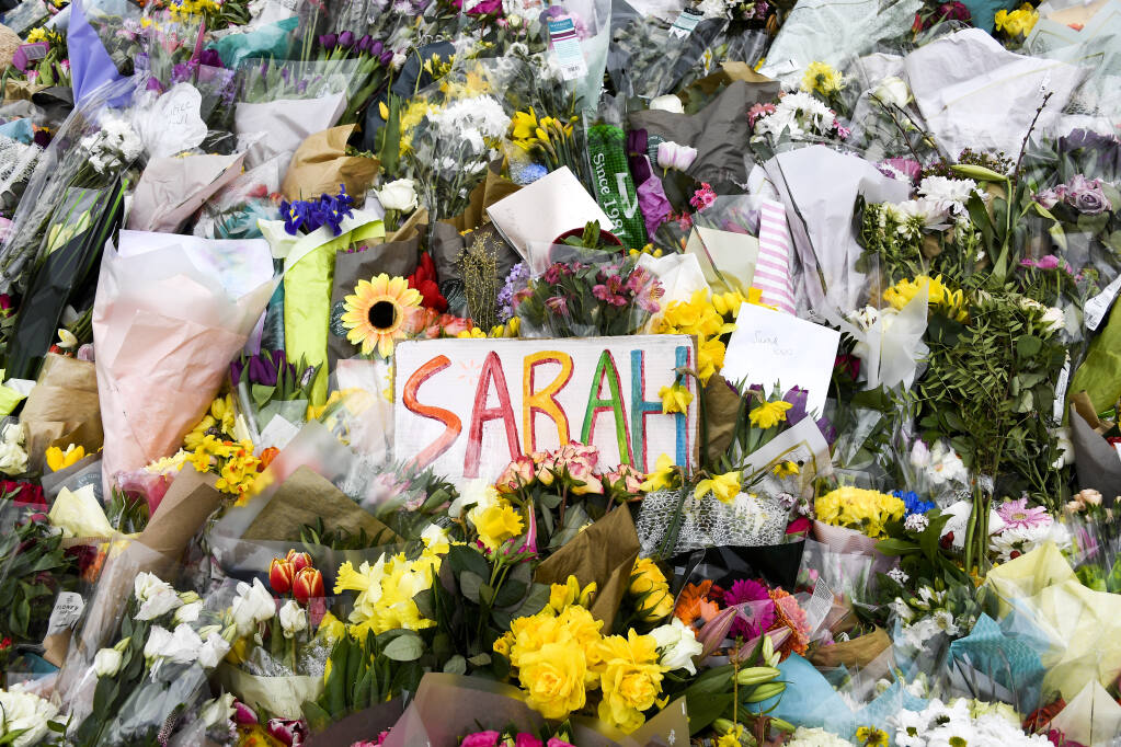 Floral tributes and messages are placed at the bandstand on Clapham Common in London, Saturday, March 20, 2021. Serving British police officer Wayne Couzens stands accused of the kidnap and murder of 33-year-old Sarah Everard, who went missing while walking home in south London on March 3.(AP Photo/Alberto Pezzali)