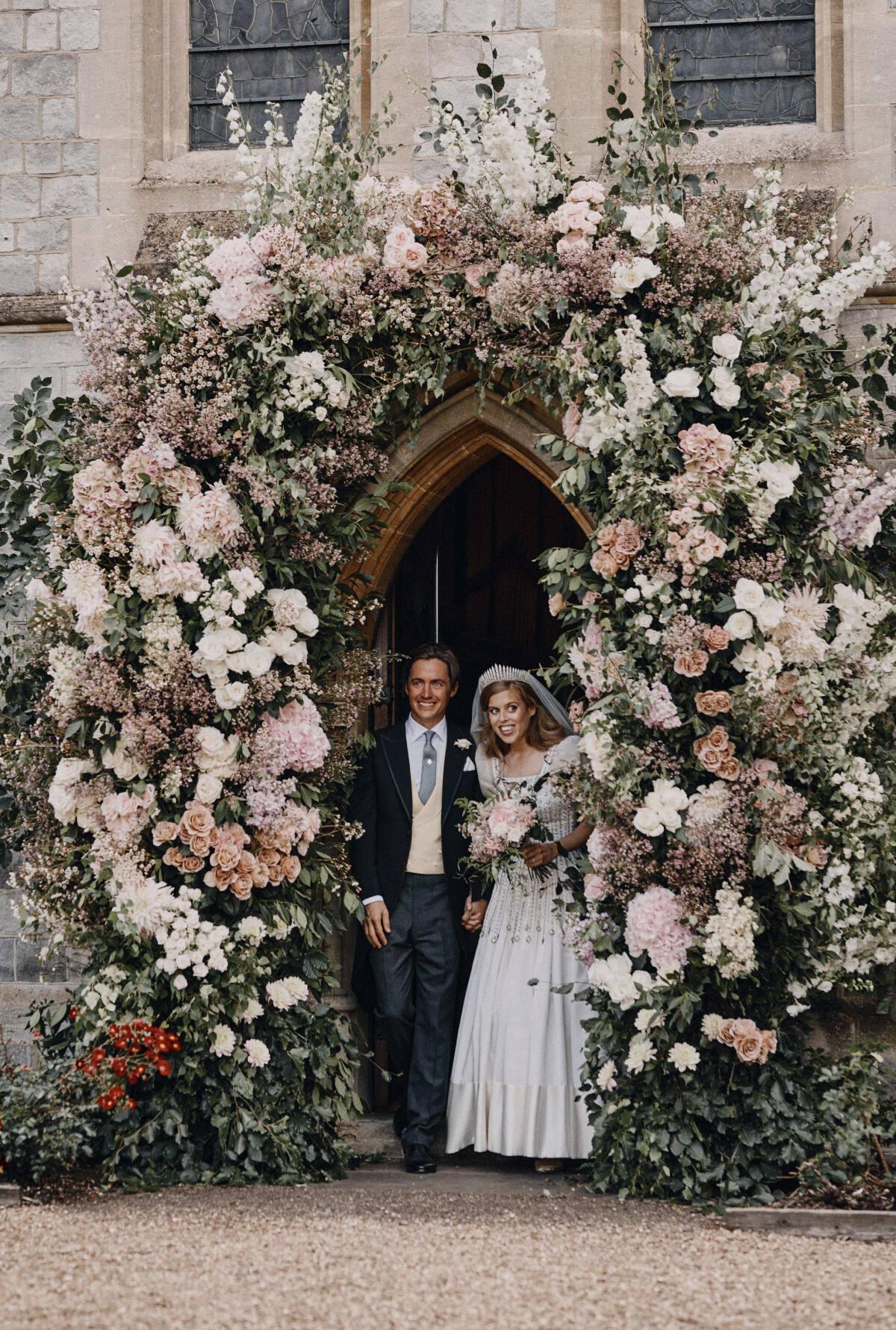Vintage dress, no Prince Andrew in Beatrice's wedding photos