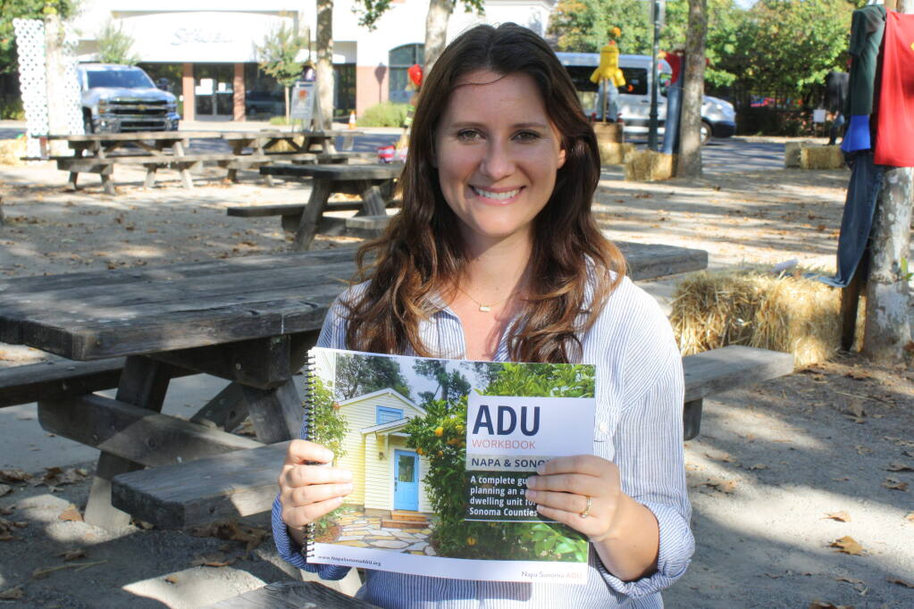 Renee Schomp, J.D., director of the Napa Sonoma ADU Center, holds the group's 110-page 110-page workbook on planning and building an accessory dwelling unit in Napa and Sonoma counties. (Gary Quackenbush / for North Bay Business Journal)