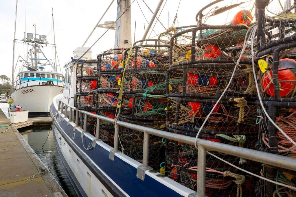 Crab pots lashed onto the deck of a fishing vessel at Spud Point Marina in Bodega Bay. (ALVIN JORNADA / The Press Democrat)