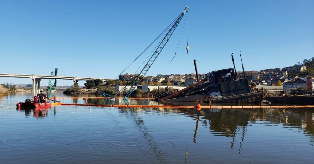 Fire crews put containment booms around fluid spill after tides partially inundate barge in Petaluma River on Sunday, Nov. 15, 2020. (Chad Costa/Petaluma Fire Department)
