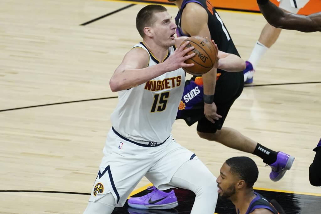 Denver Nuggets center Nikola Jokic drives against the Phoenix Suns during Game 1 of a second-round NBA playoff series on Monday, June 7, 2021, in Phoenix. (Matt York / ASSOCIATED PRESS)