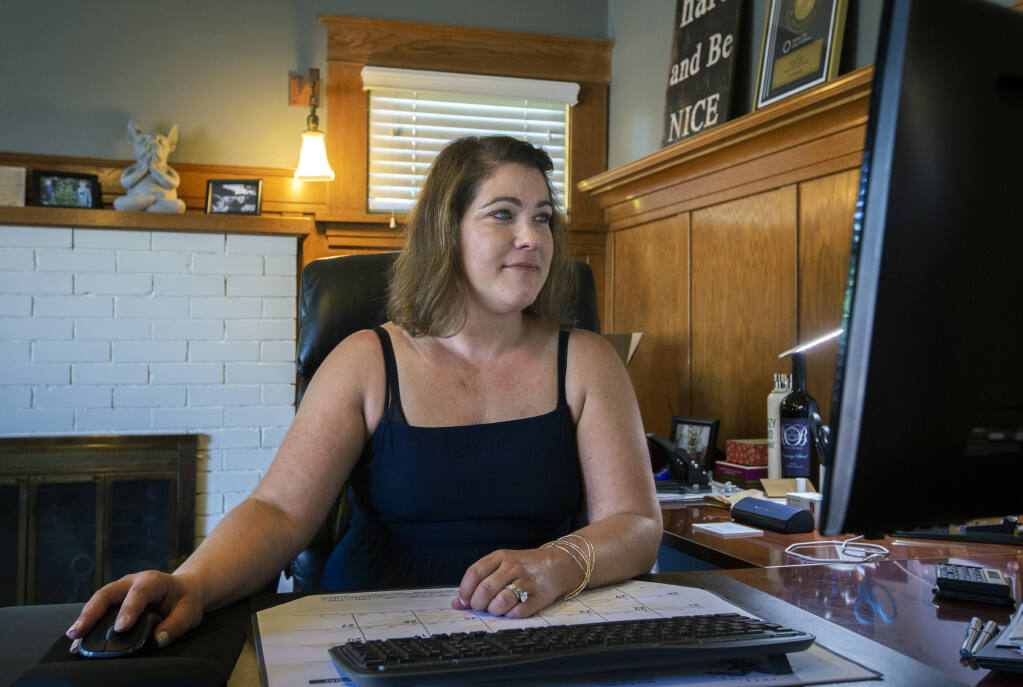 Mortgage specialist Jennifer Brown, of Crosscountry Mortgage, shown here at her office on Broadway, says the industry is in 'boom' mode. (Photo by Robbi Pengelly/Index-Tribune)