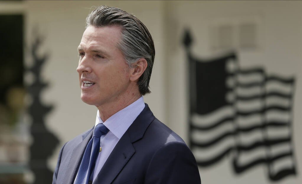 FILE - In this Friday, May 22, 2020, file photo, California Gov. Gavin Newsom speaks during a news conference at the Veterans Home of California in Yountville, Calif.  (AP Photo/Eric Risberg, Pool, File)
