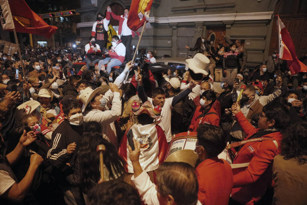 Supporters of Pedro Castillo celebrate after he was declared president-elect of Peru by the election authorities, in Lima Peru, Monday, July 19, 2021. Castillo was declared president-elect more than a month after the elections took place and after opponent Keiko Fujimori claimed that the election was tainted by fraud. (AP Photo/Guadalupe Prado)