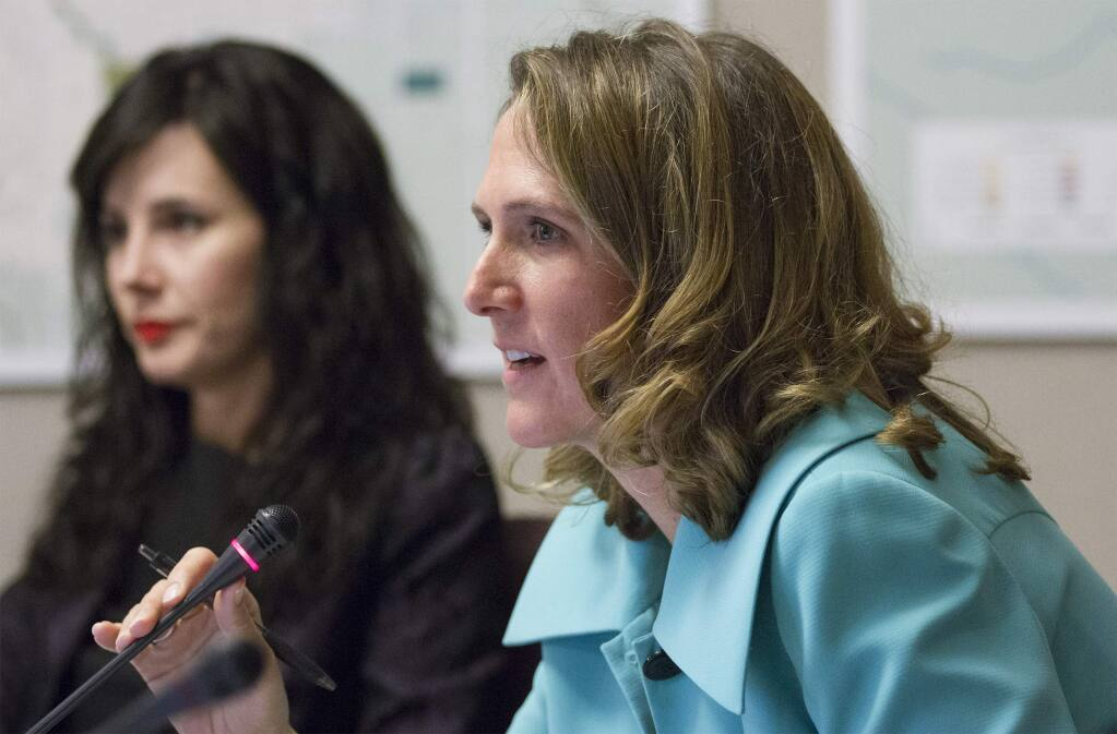 Councilmembers Amy Harrington, foreground, and Rachel Hundley, shown at a meeting in 2018, aired their differing opinions Dec. 14 on whether Hundley has had an inappropriate financial relationship with a cannabis business at the center of a council vote.