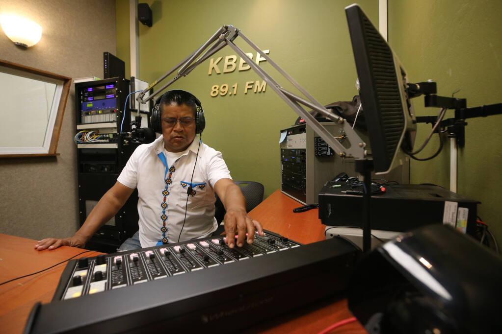 """Francisco Icala Tiriquiz hosts the show """"Rescatando Nuestras Raices y Tradiciones"""" on KBBF Radio in Santa Rosa, Calif., on Sunday, July 18, 2021.(Beth Schlanker/The Press Democrat)"""