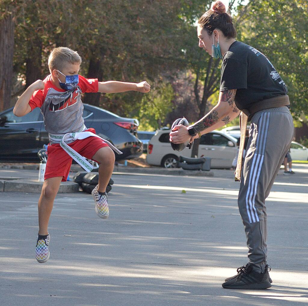 Instructor Kaylee Baum works with a young student  at Schafer's Martial Arts. (SUMNER FOWLER / FOR THE ARGUS-COURIER)