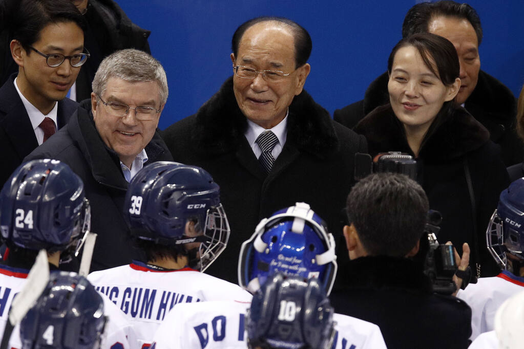 """FILE - In this Feb. 10, 2018, file photo, IOC president Thomas Bach, second from left, and Kim Yo Jong, right, sister of North Korean leader Kim Jong Un, talks with players after the preliminary round of the women's hockey game between Switzerland and the combined Koreas at the 2018 Winter Olympics in Gangneung, South Korea. North Korea has decided not to participate in this year's Olympic Games in Tokyo as it continues a self-imposed lockdown amid the coronavirus pandemic.  A website run by the North's Sports Ministry said the decision was made during a national Olympic Committee meeting on March 25, 2021 where members prioritized protecting athletes from the """"world public health crisis caused by COVID-19."""" (AP Photo/Jae C. Hong, File)"""