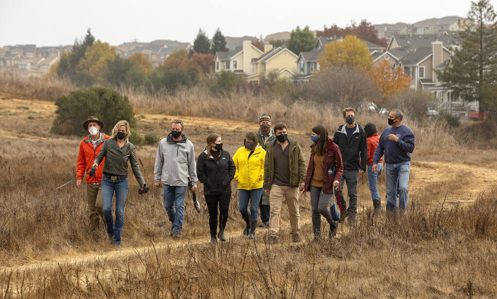 The Petaluma River Park Foundation team walks through the 20 acres at the southern tip of the McNear Peninsula on Tuesday, Nov. 17, 2020. The group raised $1 million to purchase the land where it plans a new city park. (John Burgess / The Press Democrat)