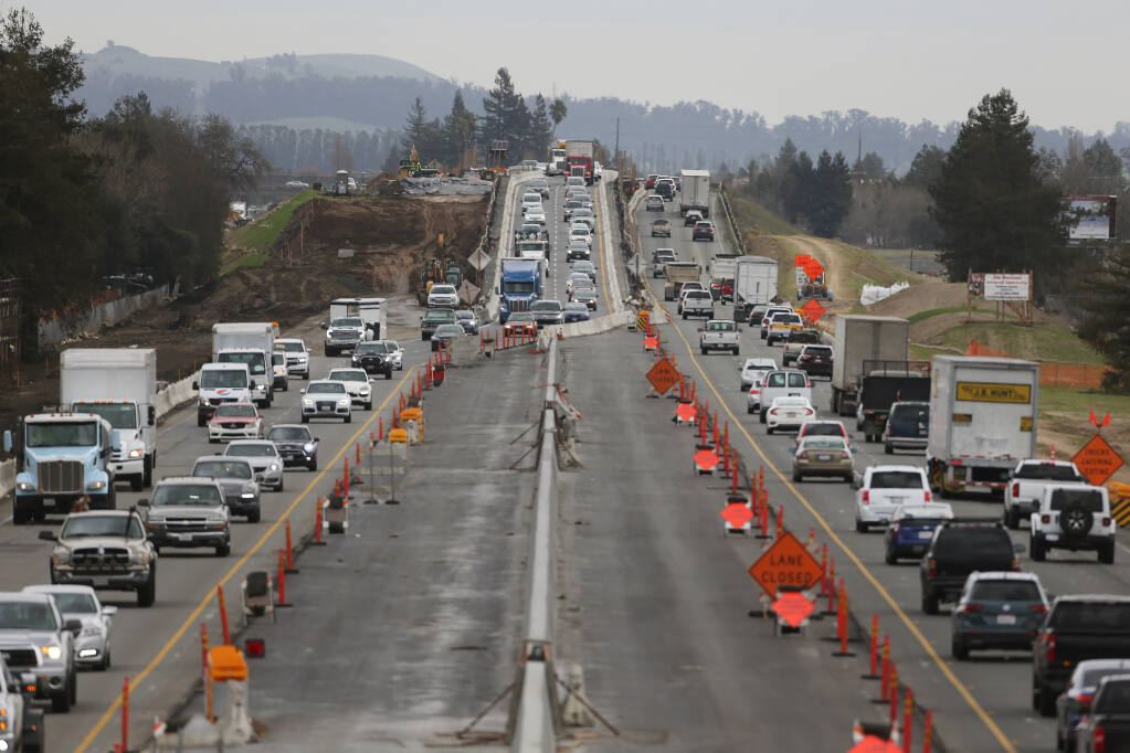 Vehicles travel along a section of Highway 101 between E. Washington St. and Corona Road where construction work is ongoing. Photo taken looking south from the Corona Road overpass in Petaluma, California, on Tuesday, January 26, 2021. (Beth Schlanker/The Press Democrat)