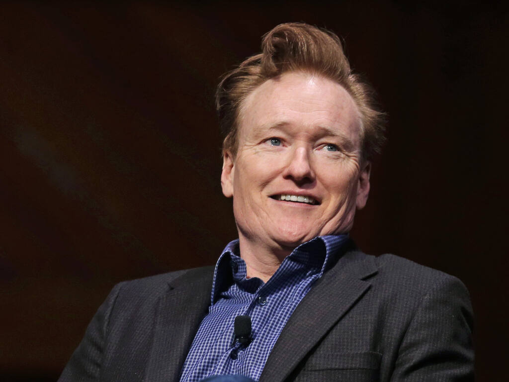 Television host Conan O'Brien smiles towards the audience at Sanders Theatre on the campus of Harvard University in Cambridge, Friday, Feb. 12, 2016.  O'Brien hosts this year's online Monte Rio Variety Show, available now. (AP Photo/Charles Krupa)