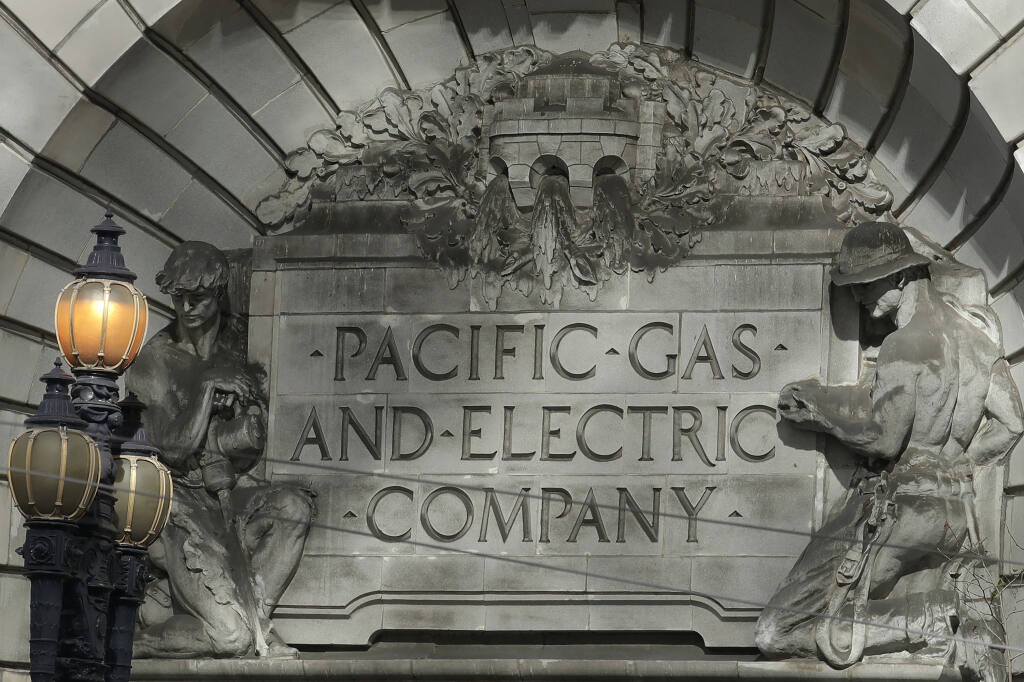 FILE - In this Oct. 10, 2019, file photo, a Pacific Gas & Electric sign is shown outside of a PG&E building in San Francisco. (AP Photo/Jeff Chiu, File)