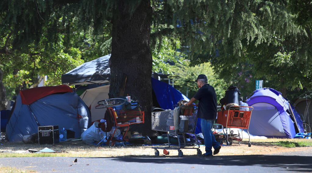 An encampment of homeless people is seen at Fremont Park in Santa Rosa on Friday, July 24, 2020.  (Kent Porter / The Press Democrat) 2020