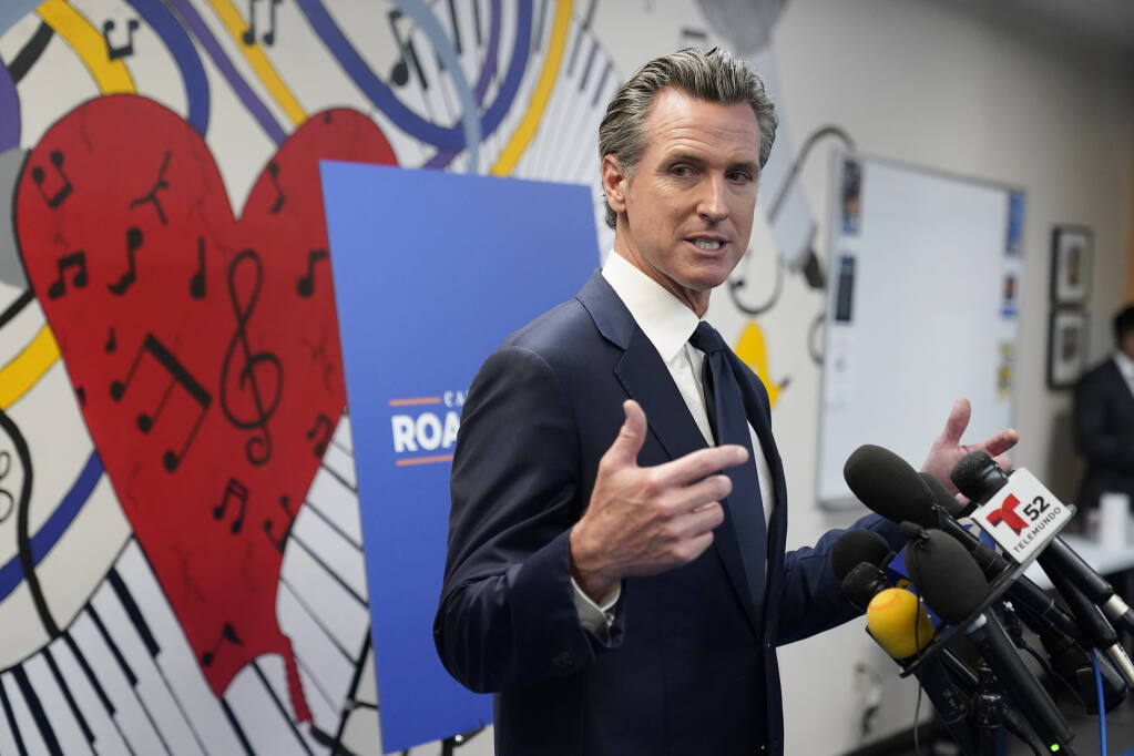 Gov. Gavin Newsom fields questions after a July 13 rally in Los Angeles. He is the subject of a Sept. 14 recall election. (MARCIO JOSE SANCHEZ / Associated Press)