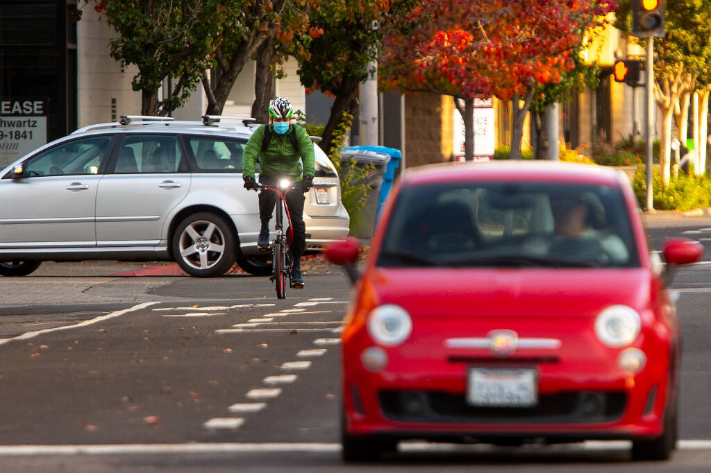 A cyclist pedals along a new bicycle lane on E Street in Santa Rosa on Wednesday, Nov. 18, 2020. Measure M transportation funds were used to help complete the project. (Alvin A.H. Jornada / The Press Democrat)
