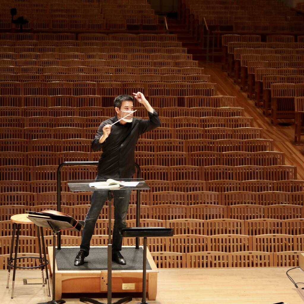 """Santa Rosa Symphony Music Director Francesco Lecce-Chong rehearses the Santa Rosa Symphony for one of its SRS @ Home virtual concert series. Three of those concerts will be televised this spring as part of """"Santa Rosa Symphony Presents."""" (Kate Matwychuk)"""