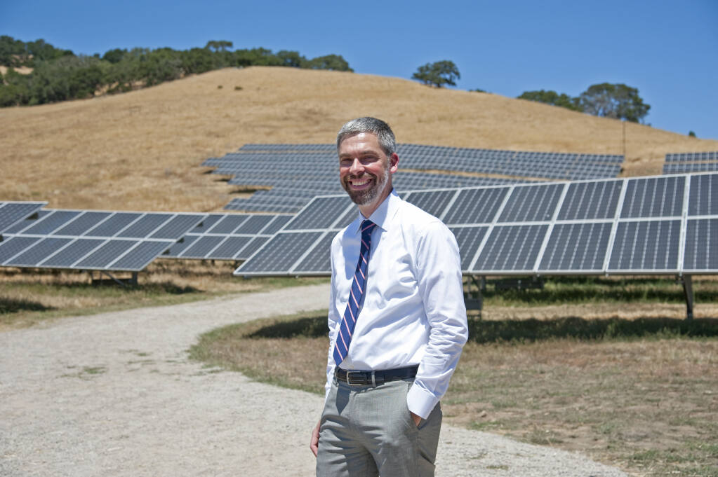 Sonoma Clean Power CEO Geof Syphers is shown in front of one of two 1-megawatt systems in rural Petaluma. The projects have the capacity to power 600 homes. (courtesy photo)