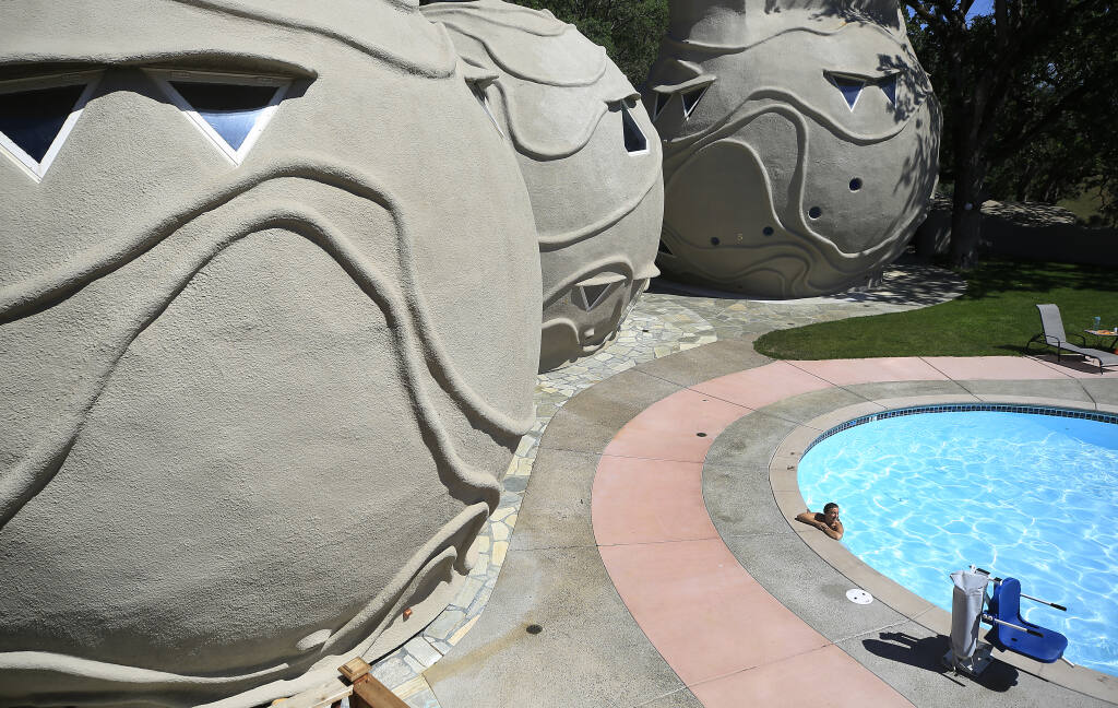 Jenifer Cutler from New York, relaxes in a pool next to rebuilt structures at Harbin Hot Springs near Middletown, Tuesday, May 4, 2021. (Kent Porter / The Press Democrat) 2021