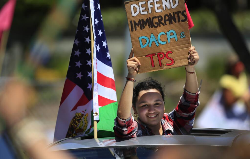 Amanda Serrano of Santa Rosa participates in the Mayday caravan for immigrant and worker's rights, Saturday, May 1, 2021 in Santa Rosa. (Kent Porter / The Press Democrat) 2021