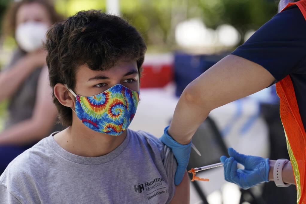 Finley Martin, 14, gets a shot of the Pfizer COVID-19 vaccine at the First Baptist Church of Pasadena Friday, May 14, 2021, in Pasadena, Calif. (AP Photo/Marcio Jose Sanchez)