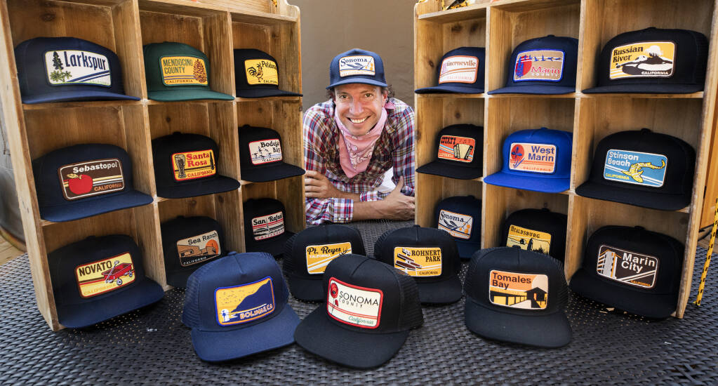 Luke Fraser's company, Bart Bridge, sold unique sports caps and apparel, but with the Warriors sliding and sports events closed due to the coronavirus, Fraser has shifted his designs to caps with Northern California city logos that he designs. Photo taken on Wednesday, Aug. 19, 2020.  (John Burgess/The Press Democrat)
