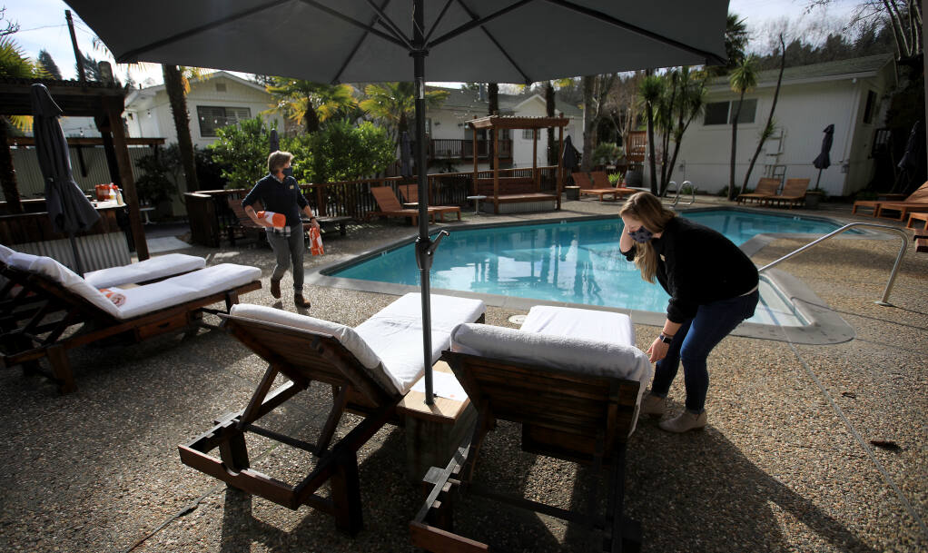 Crista Luedtke owner of Boon Hotel and Spa, left, and general manager Kristen Fisher prepare for essential travelers to the resort, Friday, Jan. 15, 2021, in Guerneville. Kent Porter / The Press Democrat) 2021