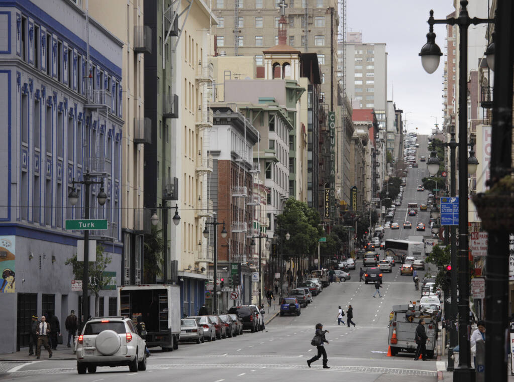 FILE - In this Feb. 15, 2011, file photo, is a view looking up Taylor Street of the Tenderloin neighborhood in San Francisco. San Francisco has sued 28 alleged drug dealers who frequent a downtown neighborhood where broad daylight drug dealing and drug use is common to stop the flow of drugs. City Attorney Dennis Herrera said Thursday, Sept. 24, 2020, the suits are part of an effort to clean up the Tenderloin, which has seen the city's largest number of overdose deaths. (AP Photo/Eric Risberg, File)
