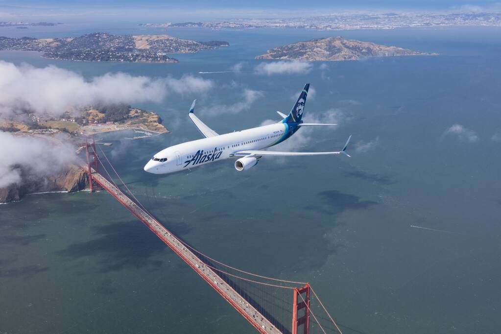 An Alaska Airlines Boeing 737-900ER plane flies over the Golden Gate Bridge in San Francisco. (Chad Slattery Photography) May 25, 2016