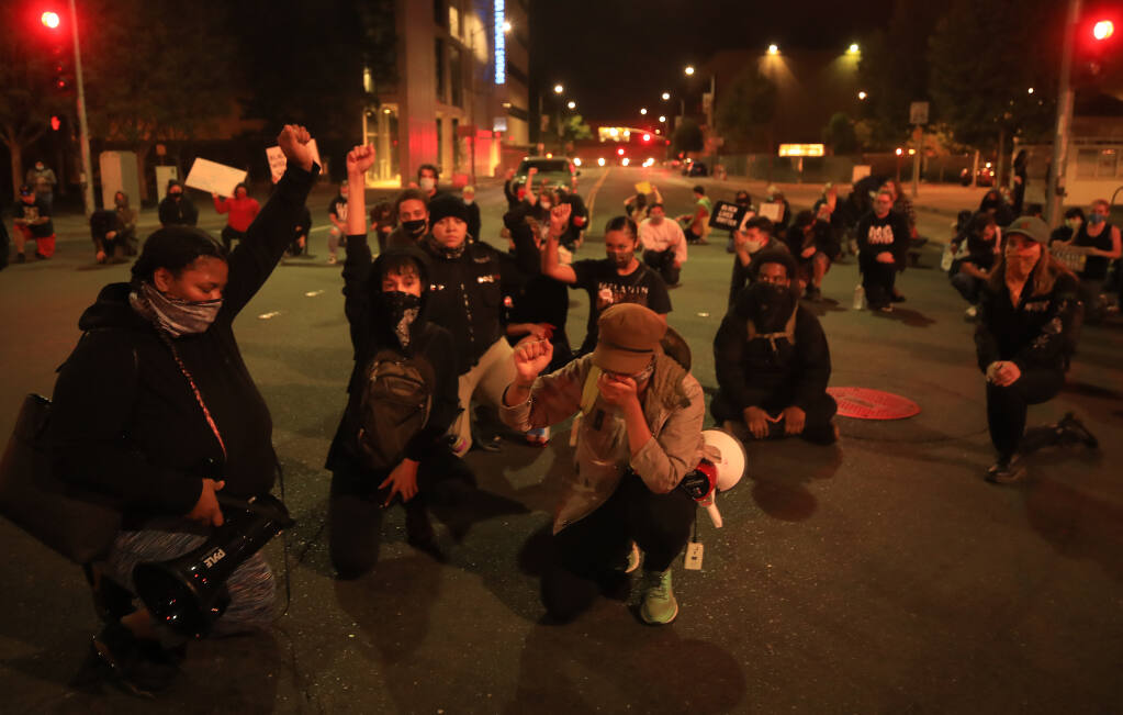 Black Lives Matter protesters kneel at Santa Rosa Ave. and Third Street in Santa Rosa, Wednesday, Sept. 23, 2020, in response to the Breonna Taylor decision in Louisville earlier in the day.(Kent Porter / The Press Democrat) 2020